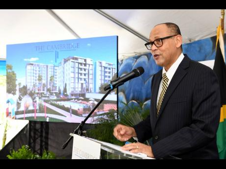 Eric Hosin, president of Guardian Life Limited, speaks at the launch of housing project The Cambridge on March 21, 2019.