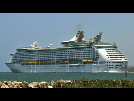 Royal Caribbean Cruise Line's 'Adventure of the Seas' docks in Falmouth on Tuesday. The ship is repatriating more than 1,044 Jamaican crew members.